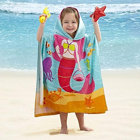 حفاظت از کودکان در برابر آفتاب کنار ساحل